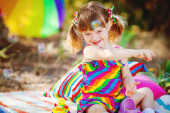 Adorable toddler girl playing outdoors in green summer park Stock Photography
