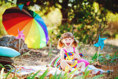 Adorable toddler girl playing outdoors in green summer park Stock Images
