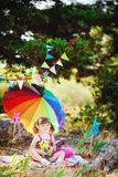 Adorable toddler girl playing outdoors in green summer park Royalty Free Stock Photography
