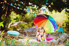 Adorable toddler girl playing outdoors in green summer park Royalty Free Stock Photos