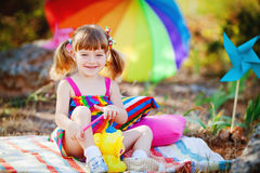 Adorable toddler girl playing outdoors in green summer park Stock Photo