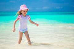 Adorable toddler girl playing in shallow water at Royalty Free Stock Images