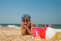 Adorable toddler girl playing with toys on sand beach Stock Images