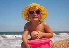 Adorable toddler girl playing with toys on sand Royalty Free Stock Images