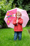 Adorable toddler girl at rainy day Stock Photos