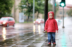 Adorable toddler girl at rainy day Stock Photo