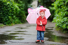 Adorable toddler girl at rainy day Stock Images