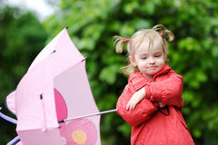 Adorable toddler girl at rainy day Stock Photography