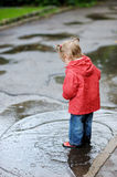 Adorable toddler girl at rainy day Royalty Free Stock Image