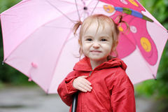 Adorable toddler girl at rainy day Royalty Free Stock Photography