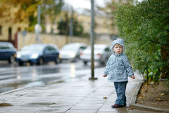 Adorable toddler girl at rainy day Stock Image