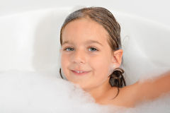 Adorable toddler girl relaxing in bathtub Royalty Free Stock Photos