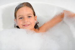 Adorable toddler girl relaxing in bathtub Royalty Free Stock Photography