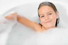 Adorable toddler girl relaxing in bathtub Royalty Free Stock Photo