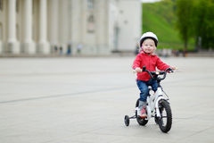 Adorable toddler girl riding her bike Stock Images