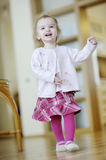 Adorable toddler girl runnig and laughing Stock Photos