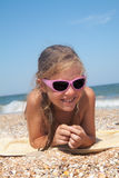 Adorable toddler girl  on sand beach Stock Photography