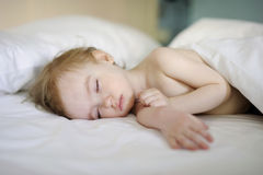 Adorable toddler girl sleeping. In a bed Royalty Free Stock Photography