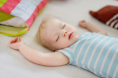 Adorable toddler girl sleeping. In a bed Stock Images