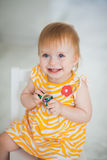 Adorable toddler girl smiling. And holding little toy in her hands Royalty Free Stock Photos