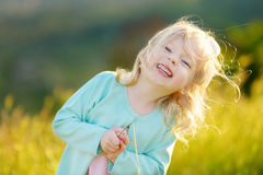 Adorable toddler girl on summer day Stock Photos