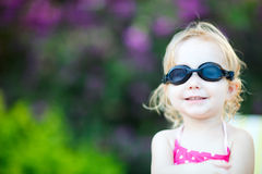 Adorable toddler girl in swimming glasses Stock Image