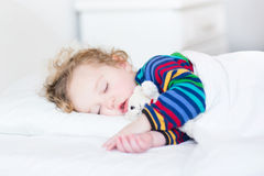 Adorable toddler girl taking a nap Royalty Free Stock Photography