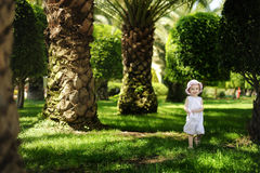 Adorable toddler girl in white dress Stock Photo