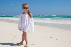 Adorable toddler girl in white dress walking at Royalty Free Stock Photography