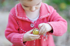 Adorable toddler playing with a chestnut Royalty Free Stock Photo