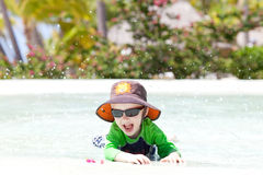 Adorable toddler by the pool Royalty Free Stock Images