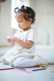 Adorable toddler. Portrait of adorable infant playing on the floor Royalty Free Stock Photos