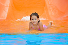 Adorable toddler relaxing in aquapark Stock Images