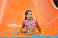 Adorable toddler relaxing in aquapark Royalty Free Stock Image