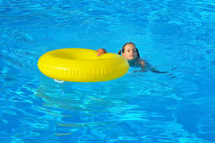 Adorable toddler relaxing in swimming pool Stock Photography