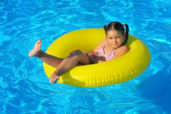 Adorable toddler relaxing in swimming pool Royalty Free Stock Images