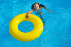 Adorable toddler relaxing in swimming pool Royalty Free Stock Photos