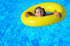 Adorable toddler relaxing in swimming pool Royalty Free Stock Image