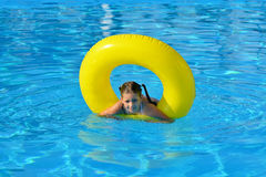 Adorable toddler relaxing in swimming pool Stock Photo