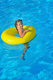 Adorable toddler relaxing in swimming pool Royalty Free Stock Photography