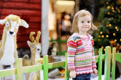Adorable toddler at shopping mall on Christmas. Day Stock Image