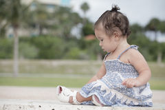 Adorable toddler sitting in the park Stock Photo