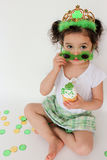 Adorable toddler on St.Patrick's Day. Adorable little girl with sun glasses and a cupcake on St.Patrick's Day Stock Photos