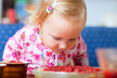 Adorable toddler with strawberry pie Royalty Free Stock Images