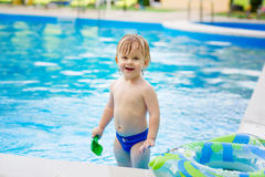 Adorable toddler in the swimming pool Stock Photography