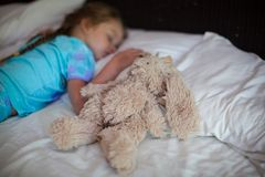 Adorable toddler taking a nap Stock Photo