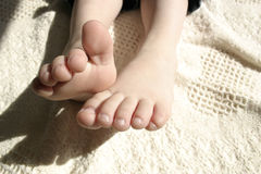 Adorable toes. Feet of toddler wiggeling toes Stock Photos