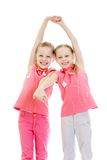 Adorable twin girls fun held hands Stock Photos