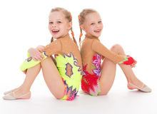 Adorable twin girls gymnasts. Stock Photography