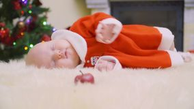 f56063533 Cute Newborn Baby Girl Lies Among Christmas Toys Stock Footage ...